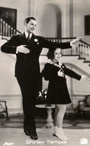 Shirley temple and George Murphy in Little Miss Broadway